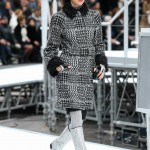 Kendall Jenner taking the runway clad in a mixed tweed coat that boasted shaggy black cuffs and collar. (Photo: WENN)