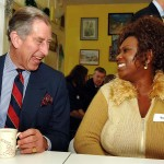 The Prince of Wales enjoying tea and giggles. (Photo: WENN)