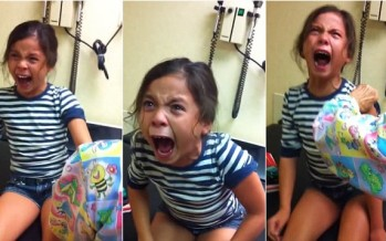 Young girl works herself into a panicked frenzy as she gets ready to have a flu shot
