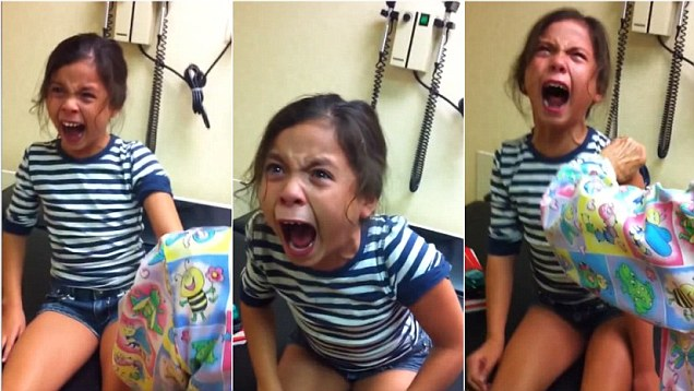 Young girl works herself into a panicked frenzy as she gets ready to have a flu shot. (Photo: YouTube)