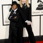 Madonna and her son David Banda in matching tuxedos at the 2013 Grammy Awards. (Photo: WENN)