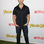 "Wearing a black polo shirt and matching black velvet shoes for the 2016 Netflix premiere of ""Fuller House"". (Photo: WENN)"