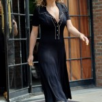 Leaving her hotel in New York in a black flowy dress and white sneakers. (Photo: WENN)