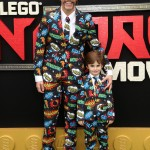 "Perez Hilton and his son, Mario Armando Lavandeira, wore this matching—and very accurate—outfits to the ""Lego Ninjago Movie"" premiere in Los Angeles. (Photo: WENN)"