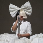 Her iconic bicolor brunette and blonde wig is usually topped with a gigantic bow that comes in all shapes and colors… (Photo: WENN)