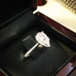 Cuoco's engagement ring is a huge tear drop-shaped diamond, on a band encrusted with small diamonds. (Photo: Instagram)