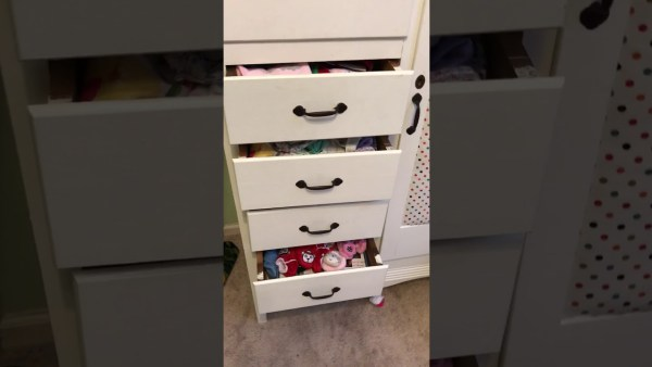 A little boy managed to get stuck inside a chest of drawers, and his dad captured the whole thing in video! (Photo: Facebook)