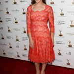 Mayim Bialik in a red lace dress at the 65th Primetime Emmy Awards Performer Nominee Reception. (Photo: WENN)