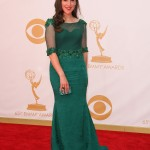 """The Big Bang Theory"" actress went from geek to glam in an emerald green dress by Oliver Tolentino at the 2013 Emmy Awards. (Photo: WENN)"