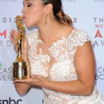 Gina Rodriguez posing with the Special Achievement in Film Award at the 2013 NCLR ALMA Awards. (Photo: WENN)