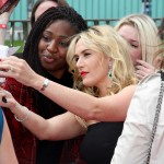 Kate Winslet taking a selfie with a fan at the Divergent European Premiere in London. (Photo: WENN)