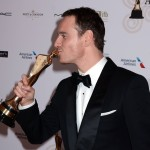 Michael Fassbender celebrating after winning Best Supporting Film Actor at the 2014 IFTA Awards. (Photo: WENN)