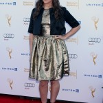 Mayim wore a metallic gold dress paired with a black jacket and matching heels at the 66th Annual Emmy Awards Performers Nominee Reception in 2014. (Photo: WENN)