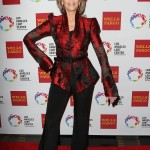 The screen vet wore a red and black brocade jacket with solid slacks at the Los Angeles LGBT 46th Anniversary Gala Vanguard Awards. (Photo: WENN)