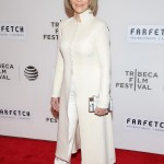The actress looked incredible as she oozed elegance in an all-white ensemble, highlighting her toned physique in a form-fitting long coat at the 2016 Tribeca Film Festival. (Photo: WENN)
