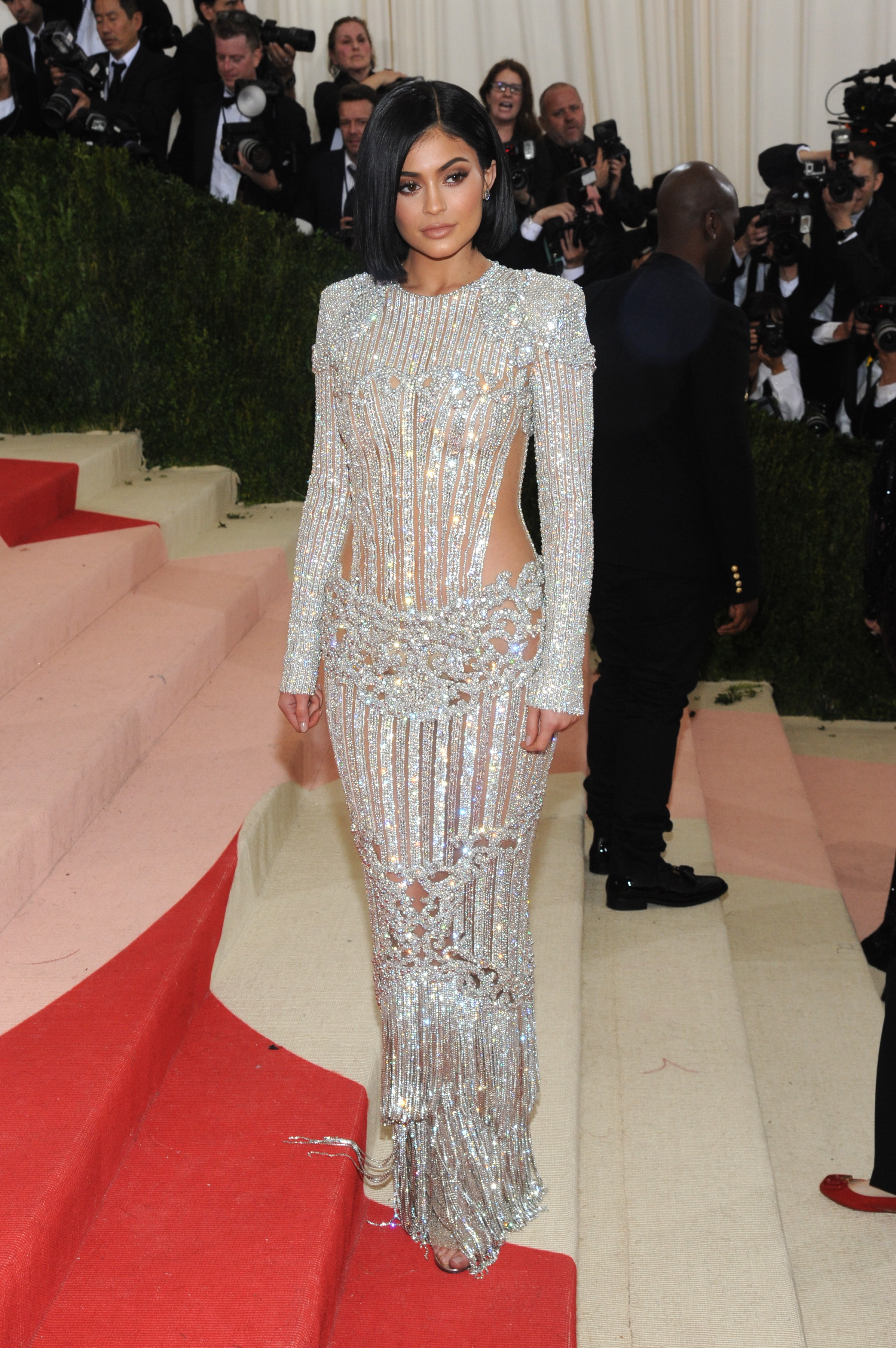 2236d7e5f3 Kylie Jenner made her Met Gala debut at the 2016 red carpet wearing a  beaded silver