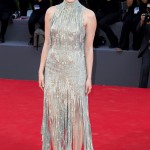 A dazzling Emma Stone sported an embellished silver gown by Versace at the La La Land premiere for the 2017 Venice Film Festival opening. (Photo: WENN)