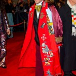 Leto wore a red coat adorned with characters such as Donald Duck, complementing the whimsical statement with trim trousers, a dandy bow-tie, and leather loafers. (Photo: WENN)