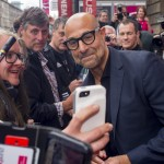 Stanley Tucci taking a selfie with a fan at the 71st Edinburgh International Film Festival. (Photo: WENN)
