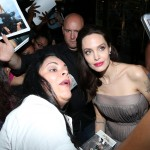"Angelina Jolie and taking a selfie with her fans at the ""First They Killed My Father"" NY premiere. (Photo: WENN)"