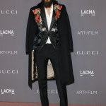 Jared Leto's outfit was on trend with the floral theme at the 2017 LACMA gala with a floral-embroidered evening jacket and cape-like coat designed by Gucci. (Photo: WENN)