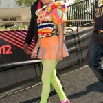 We're not sure what's worse: either her shoes, her leggings, or that colorful puffy sweater! (Photo: WENN)