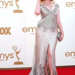 Christina Hendricks poured bombshell curves into the 2011 Emmy Awards in a silk silvery satin gown by Johanna Johnson. (Photo: WENN)