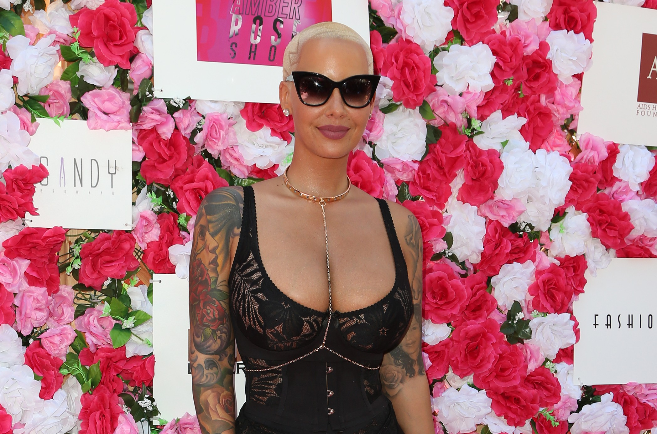 Amber Rose boasted her new cleavage after having undergone breast reduction surgery. (Photo: WENN)