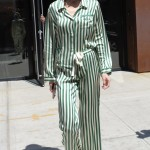 Gigi Hadid stepped out in public wearing the chicest green pajamas paired with heeled sandals as she left a New York City hotel. (Photo: WENN)