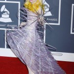 Lady Gaga stuck to a futuristic space theme stepping out in a dress that resemble and orbit and carrying a star at the 2010 Grammys. (Photo: WENN)