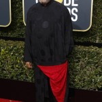 The Matrix star Laurence Fishburne ditched the usual suit and tie and stood out in a black kimono with a red lining instead and a pair of red shoes. (Photo: WENN)