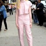 "Elle Fanning made an appearance on the ""Late Show With David Letterman"" wearing a cute pink striped crop top with matching pants that looked like pajamas. (Photo: WENN)"