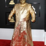 Cee Lo Green turned heat at the 2017 Grammy Awards when he attended the ceremony dressed in this bizarre gold from head to toe outfit—including a gold mask. (Photo: WENN)