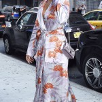 Rihanna arrived at a wedding reception in a lilac floral robe silk dress with matching purse and silver heels. (Photo: WENN)
