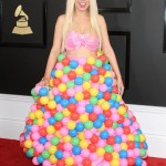 Pop artist Girl Crush wore a hot-pink bralette and a full skirt emblazoned with brightly colored gumballs at the 2017 Grammy Awards red carpet. (Photo: WENN)
