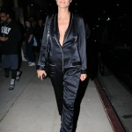 Heidi Klum took the pajama dressing trend to hear wearing actual pj's and strappy black heels for an art opening in Los Angeles. (Photo: WENN)