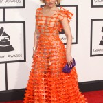 Joy Villa wore an orange netting plastic dress that was as revealing as it was weird at the Grammys 2015 red carpet. (Photo: WENN)
