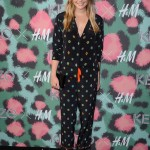 The always fashionable Elizabeth Olsen showed up wearing a stylish silk pajamas suit to the KENZO x H&M fashion show. (Photo: WENN)