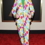 "Bill Kelliher from ""weirdo"" heavy rock band Mastodon wore a suit bedecked with rainbow palette of balloons that made his look like a clown at the 2015 Grammy Awards. (Photo: WENN)"
