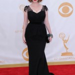 Christina Hendricks turned to Christian Siriano to create her black gown with lace detailing that hugged every curve of her signature figure for the 2013 Emmys. (Photo: WENN)