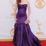 Alyson Hanningan wore a purple strapless prom dress by Marchesa to the Primetime Emmy Awards red carpet in 2013. (Photo: WENN)