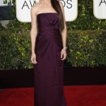 Katie Holmes looked stunning in a draped strapless purple gown with a mid-length train by Marchesa at the 2015 Golden Globe Awards. (Photo: WENN)