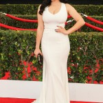 Ariel rocked her hourglass curves in an all-white plunging Zac Posen dress at the 2015 SAG Awards red carpet. (Photo: WENN)