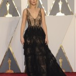 Jennifer Lawrence stunned in a sheer lace Dior gown with a plunging neckline for the 2016 Oscar red carpet. (Photo: WENN)