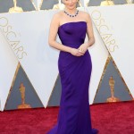 Tina Fey wore chose a purple strapless chiffon Versace dress to walk down the red carpet of the 2016 Academy Awards ceremony. (Photo: WENN)