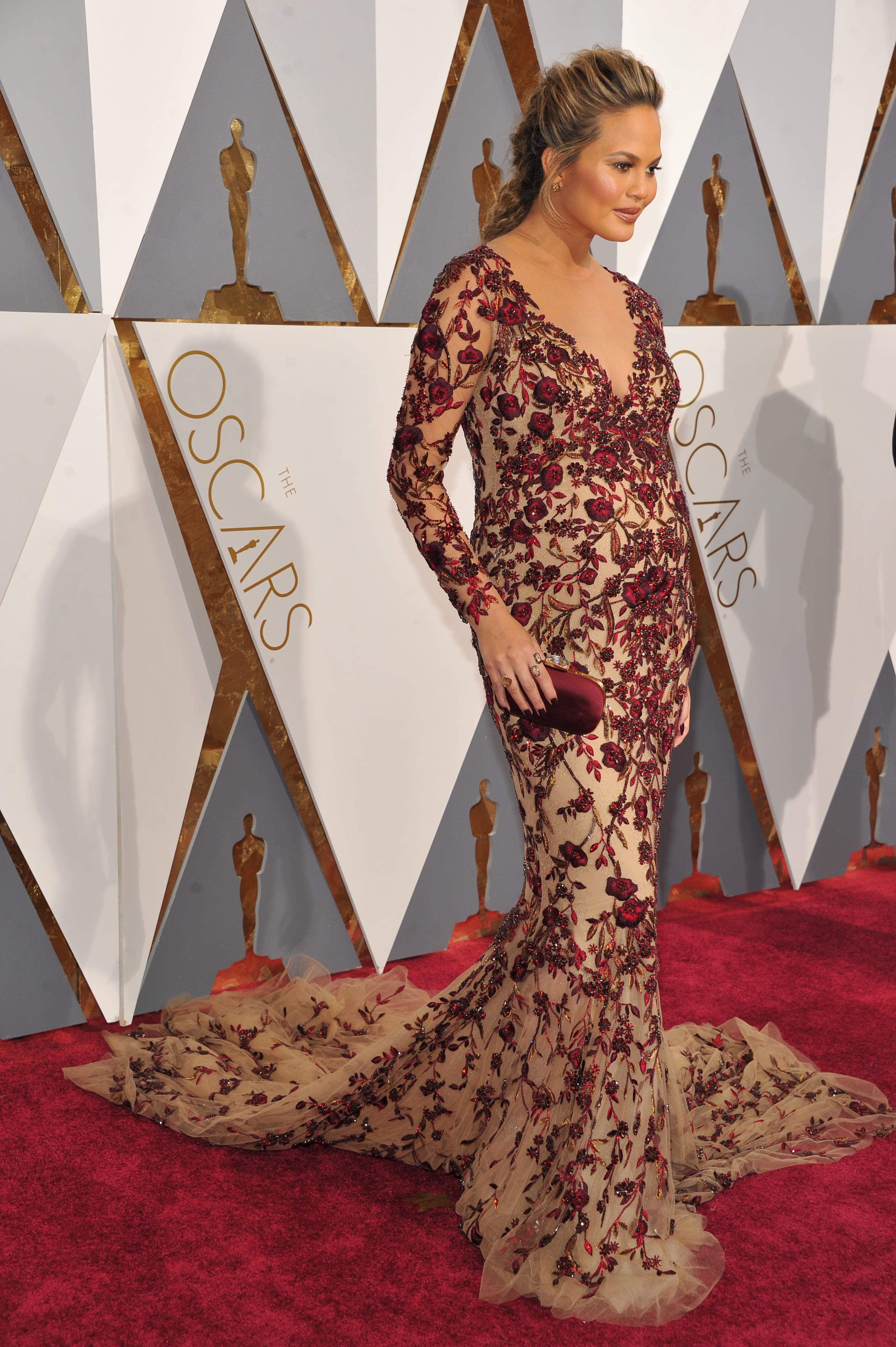 534f1e98a4f Chrissy Teigen wore a bump-skimming Marchesa dress that perfectly hugged  her pregnancy curves at