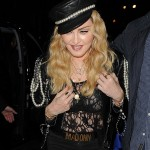 Madonna wore and pearl embellished, black leather conductor hat to a Mark's Club VIP party. (Photo: WENN)
