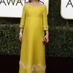 A pregnant Natalie Portman donned a long-sleeved bright yellow, embellished Prada gown to the 2017 Golden Globe Awards. (Photo: WENN)