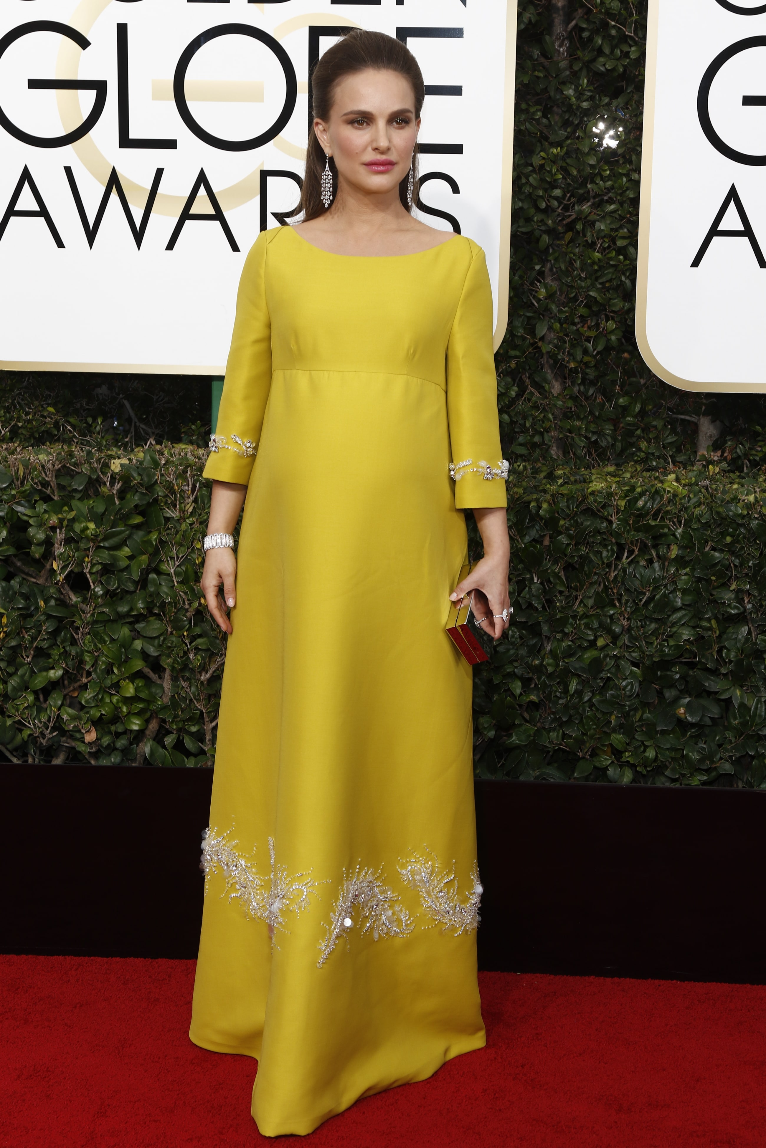 8b6ddc5304637 A pregnant Natalie Portman donned a long-sleeved bright yellow, embellished  Prada gown to