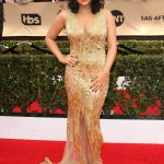 Ariel turned heads at the 2017 SAG Awards red carpet wearing a glamorous, sheer gold embellished dress by Mikael D. (Photo: WENN)